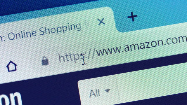 typing the amazon's url on web browser - e commerce stock videos & royalty-free footage