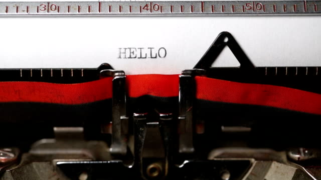 hello - typing with an old typewriter - greeting stock videos & royalty-free footage