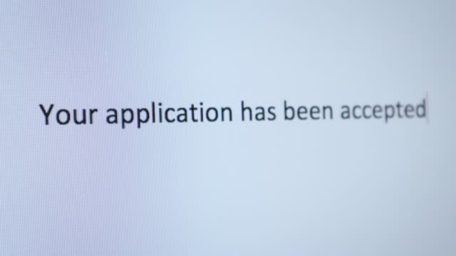"""typing """"your application has been accepted"""" on the computer - applying stock videos & royalty-free footage"""