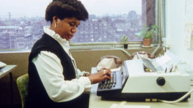 montage typist using a desk terminal microcomputer in an office / united kingdom - anno 1983 video stock e b–roll