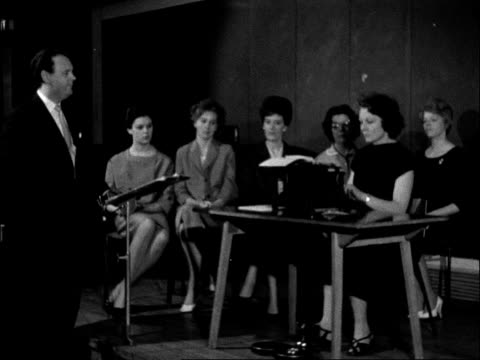 typists audition for a part in ballet; england: london: royal festival hall: int man giving instruction to group of female typists sot / young women... - soloist stock videos & royalty-free footage