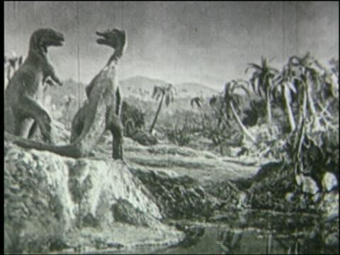 b/w tyrannosaurus rex fighting + killing brachiosaurus in jungle - tyrannosaurus rex stock videos and b-roll footage
