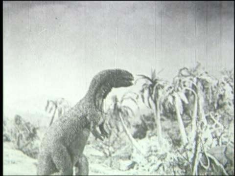 b/w tyrannosaurus rex roars + walks off-screen in jungle - tyrannosaurus rex stock videos and b-roll footage