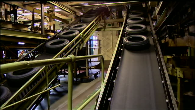 Tyres on a conveyor belt at a factory in Dundee