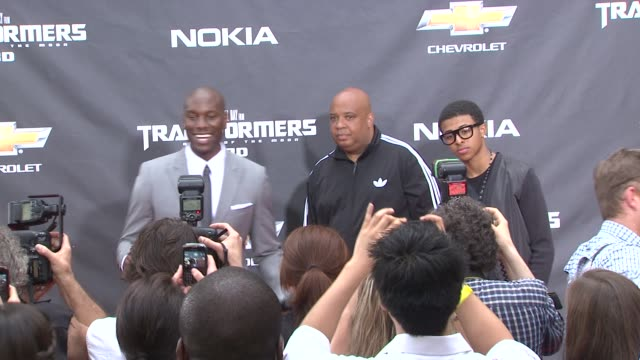 tyrese gibson and rev run and guest at the 'transformers dark side of the moon' new york premiere at new york ny - tyrese stock videos and b-roll footage