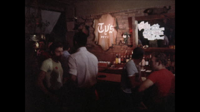 stockvideo's en b-roll-footage met ty's bar on christopher street in new york city in the 1970s. - healthcare and medicine or illness or food and drink or fitness or exercise or wellbeing