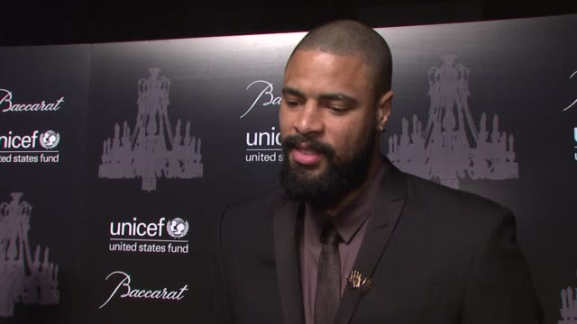 interview tyson chandler jokes that he checks on the giant unicef snowflake he lit in november on his work as a unicef ambassador on what has been... - family back lit stock videos & royalty-free footage