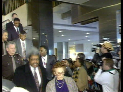 indiana indianapolis la ms don king camille ewald with mike tyson behind down stairs pan lr to bv out door - mike tyson boxer stock videos and b-roll footage
