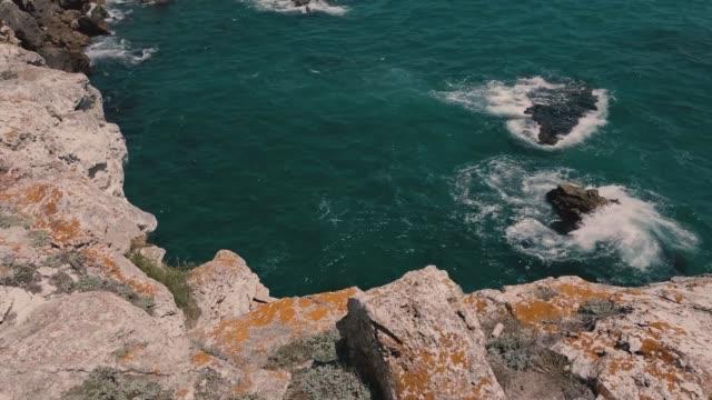 stockvideo's en b-roll-footage met tyulenovo is a village and seaside resort on the north bulgarian black sea coast, part of shabla municipality, dobrich province. tyulenovo means... - verschijning