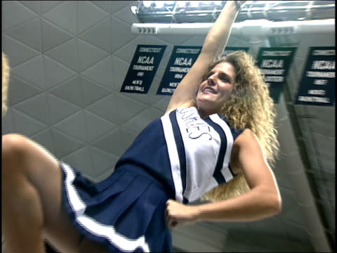 uconn cheerleaders doing a cheer for crowd - cheerleader stock videos & royalty-free footage