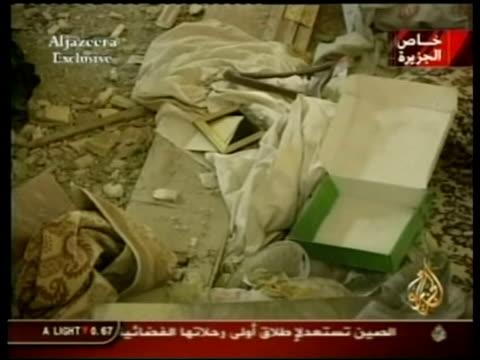 Photos released AL JAZEERA IRAQ Nr Mosul Logo on screen EXT Debris inside villa where Saddam Hussein's sons Uday Qusay were killed ZOOM IN INT...
