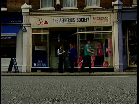 london: fulham: dr john holder intvwd sot holder & jordan chatting outside shop 'the aetherius society' tx 24.6.97/c5n - ufo stock videos & royalty-free footage