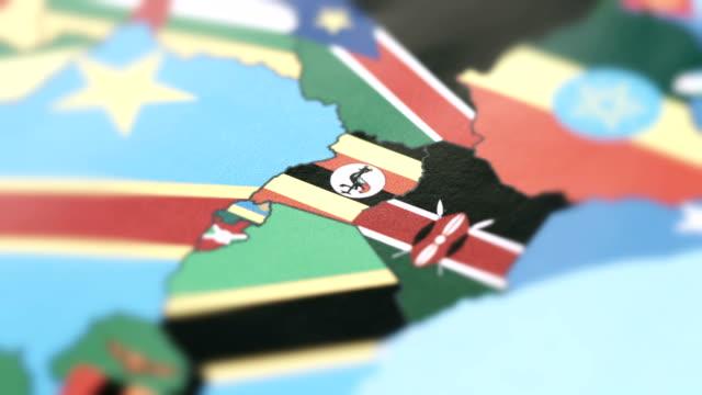 Uganda Borders with National Flag on World Map
