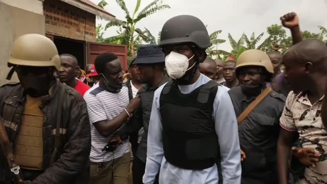uganda elections marred by violence against opposition; uganda: ext bobi wine along with security through crowd as attending funeral of elijah... - politics stock videos & royalty-free footage