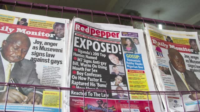 ugandan newspaper listed tuesday 200 people it accused of being gay, a day after the president called homosexuals mercenaries and signing one of the... - kampala stock-videos und b-roll-filmmaterial