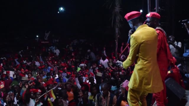 ugandan pop star turned opposition mp bobi wine appears on stage on the outskirts of the capital kampala in a concert attended by several members of... - popmusik konzert stock-videos und b-roll-filmmaterial