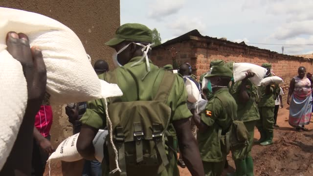ugandan soldiers handing out supplies during covid-19 outbreak in slums of kampala. - kampala stock videos & royalty-free footage
