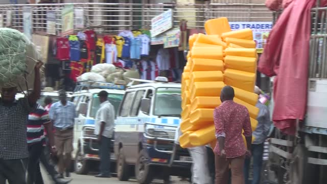 vidéos et rushes de uganda's capital city kampala is a bee hive of activities as over two million people go around with their businesses. footage shows people at work on... - kampala