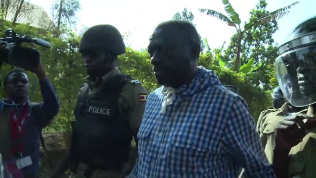 uganda's main opposition leader kizza besigye is taken to a kampala police station from his home where he has been under house arrest since friday - kampala stock videos & royalty-free footage