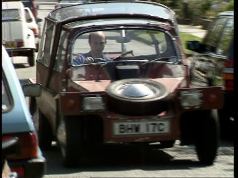 middlesex: harrow tony alexander driving 'world's ugliest car' along tcms 'turbo' sticker on boot cms front of ugly car tcms patchy paintwork on body... - harrow stock videos & royalty-free footage