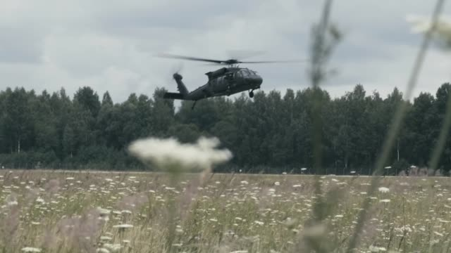 uh60 black hawk pilots and crewmen with the us army's 4th combat aviation brigade task force comanche north currently deployed to latvia readying for... - black hawk helicopter stock videos and b-roll footage