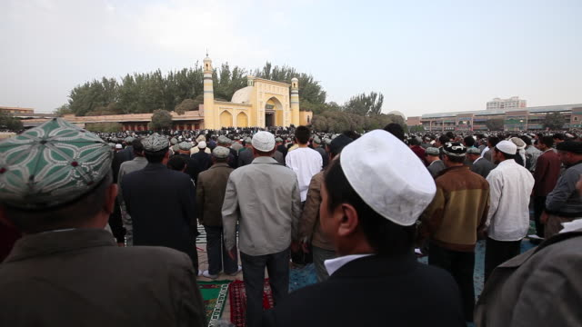 uighur muslims gather at id kah mosque for prayer - religion stock videos & royalty-free footage