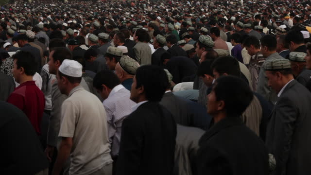 uighur muslims gather at id kah mosque for prayer - xinjiang province stock videos & royalty-free footage