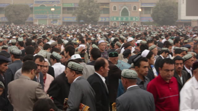 uighur muslims gather at id kah mosque for prayer - islam stock videos & royalty-free footage