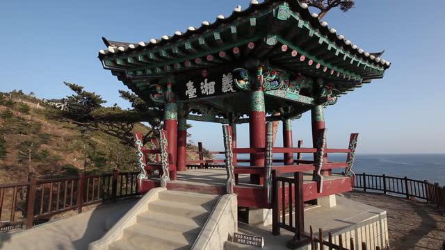 uisangdae pavilion in naksansa temple / yangyang-gun, gangwon-do, south korea - temple building stock videos & royalty-free footage