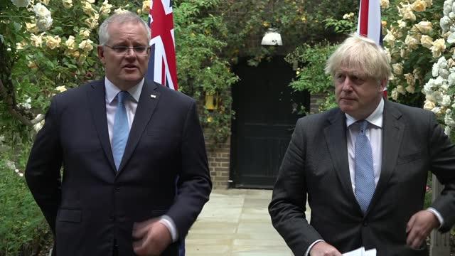 australia trade deal: boris johnson and scott morrison joint press conference; england: london: westminster: downing street: scott morrison statement... - add list stock videos & royalty-free footage