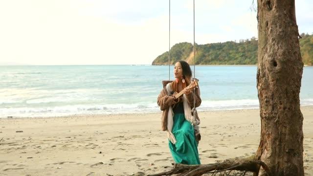 ukelele fun on a beach swing - rope swing stock videos & royalty-free footage