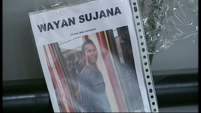 day of mourning gv malaysian airlines banner close shot missing person poster 'wayan sujana' various of passengers in airport terminal - missing poster stock videos & royalty-free footage
