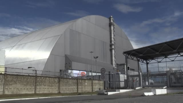 ukraine and its european partners formally inaugurate a new metal dome encasing the destroyed reactor at the infamous chernobyl plant wrapping up a... - infamous stock videos & royalty-free footage