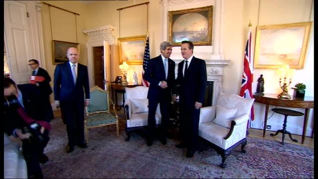London talks fail to achieve diplomatic breakthrough ENGLAND London 10 Downing Street John Kerry photocall handshake standing with David Cameron MP...