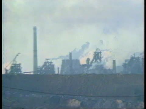 ukraine democratic struggles; lgv heavy industrial plant zoom in smoking chimneys & steaming cooling towers int tms workers in engineering workshop -... - ukraine stock videos & royalty-free footage