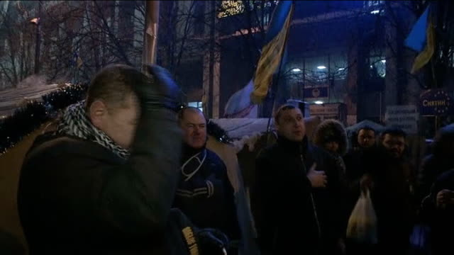 Prime Minister Mykola Azarov resigns UKRAINE Kiev EXT GVs AntiGovernment protesters with hands on hearts singing National anthem SOT Protester...