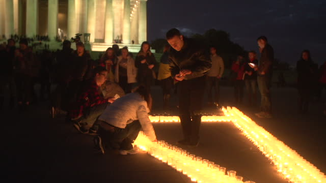 ukraine supporters gather in front of the lincoln memorial for a flash mob organizer explains gathering in right audio channel - flash mob stock videos and b-roll footage