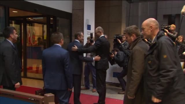 Ukraine's Prime Minister Arseniy Yatsenyuk meets with European Council President Donald Tusk at the European Council in Brussels Belgium on December...