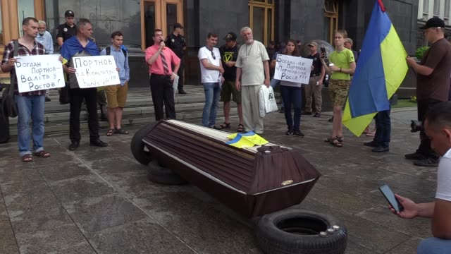 Ukrainian activists attend a rally during a symbolic funeral of the Ukrainian Constitution outside the Presidential office in Kiev Ukraine 27 June...