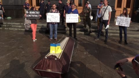 ukrainian activists attend a rally during a symbolic funeral of the ukrainian constitution, outside the presidential office in kiev, ukraine, 27 june... - 2010 2019 stock videos & royalty-free footage