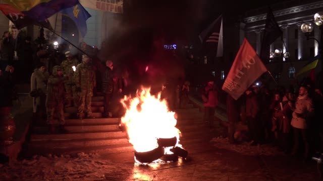 Ukrainian activists burn tires during rally dedicated to the third anniversary of the Euromaidan Revolution at Independence Square in Kiev Ukraine21...