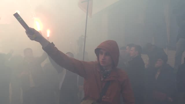 ukrainian activists of national corps burn torchesmake graffitiand build a wall which block entrance to the sberbank of russiaduring a protest in... - ukraine stock-videos und b-roll-filmmaterial