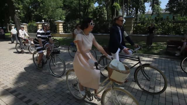 Ukrainian cyclists dressed in retro outfits attend the Spring Festival Retro Cruise 2019 bikes ride in downtown Kiev Ukraine 19 May 2019 The event...