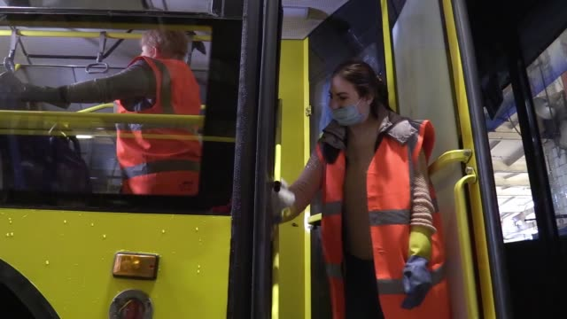 ukrainian employees wearing protective face masks disinfects an a public trolley bus as part of precautionary measures against the spread of the... - trolley bus stock videos & royalty-free footage