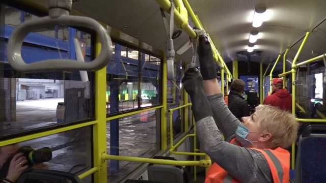 ukrainian employees wearing protective face masks disinfects an a public trolleybus as part of precautionary measures against the spread of the... - trolleybus stock-videos und b-roll-filmmaterial