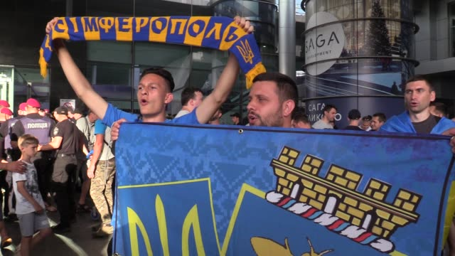 ukrainian fans celebrate upon the arrival of the ukrainian national soccer team at boryspil international airport near kiev, ukraine, 16 june 2019.... - international team soccer stock videos & royalty-free footage
