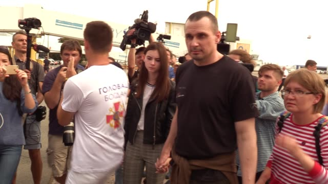 ukrainian film director oleg sentsov who was jailed on terrorism charges in russia walks with his relative upon arrival during a welcoming ceremony... - political prisoner stock videos & royalty-free footage