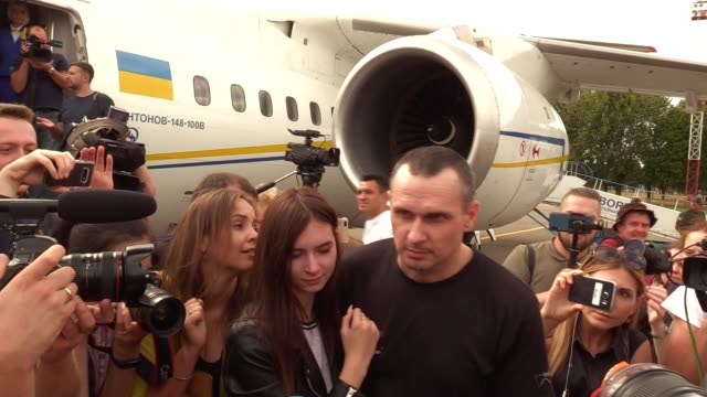 ukrainian film director oleg sentsov who was jailed on terrorism charges in russia hugs his relative upon arrival during a welcoming ceremony after... - political prisoner stock videos & royalty-free footage