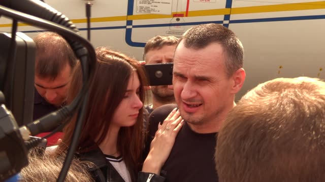 ukrainian film director oleg sentsov who was jailed on terrorism charges in russia speaks to journalists upon arrival during a welcoming ceremony... - political prisoner stock videos & royalty-free footage