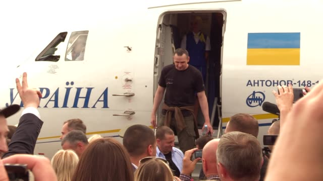 ukrainian film director oleg sentsov who was jailed on terrorism charges in russia leaves a plane upon arrival during a welcoming ceremony after... - political prisoner stock videos & royalty-free footage